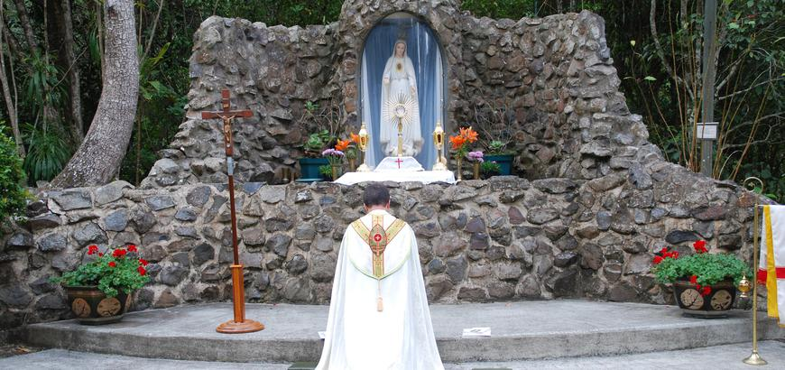 Fr. Albert leading devotions at the Fatima Grotto.